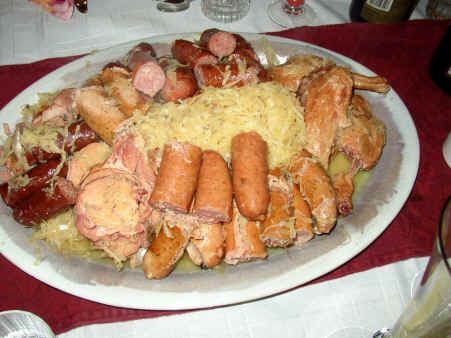Choucroute is prepared with sausages and meat for lunch
